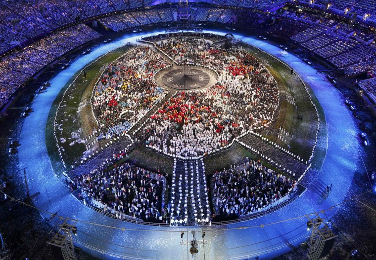 Athletes of participating countries stand in the middle of the Olympic Stadium after the athletes parade at the opening ceremony of the London 2012 Olympic Games. (Pawel Kopczynski/Reuters)