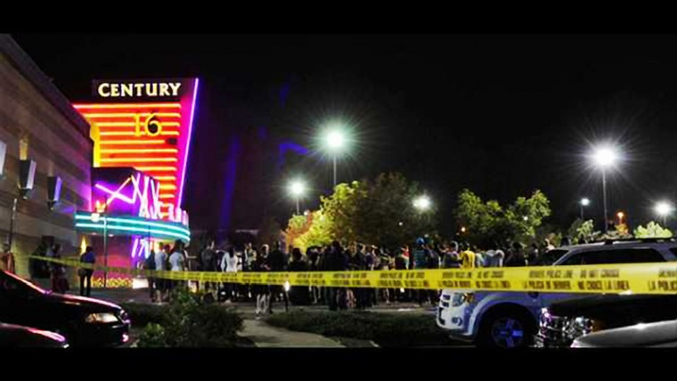 """A gunman killed 12 people and wounded dozens when he opened fire on moviegoers at a showing of """"The Dark Knight Rises"""" near Denver in the early hours. (KDVR/KWGN Denver)"""