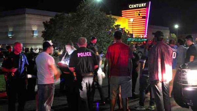 "A gunman killed 12 people and wounded dozens when he opened fire on moviegoers at a showing of ""The Dark Knight Rises"" near Denver in the early hours. (KDVR/KWGN Denver)"