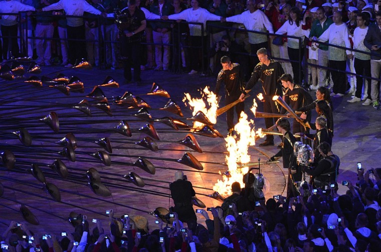 Athletes light the Olympic fire during the opening ceremony of the London 2012 Olympic Games at the Olympic Stadium in London. (Saeed Khansaeed/AFP/Getty Images)