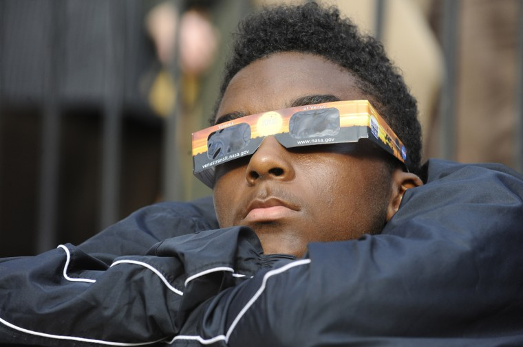 Julian Harris, 17, of Baltimore, watches the Venus Transit with a plastic solar viewer at the Maryland Science Center, which hosted a Transit of Venus event for the viewing of the planet Venus as it moves across the face of the sun for over six hours. The Transit of Venus last occurred in 2004 and will not occur again until 2117. (Kenneth K. Lam/The Baltimore Sun)