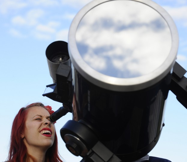 Erika Lipitz, of Baltimore, looks through a telescope to view the Transit of Venus at The Science Center, which hosted a Transit of Venus event for the viewing of the planet Venus as it moves across the face of the sun for over six hours. The transit was only visible at the Science Center for about two hours. The Transit of Venus last occurred in 2004 and will not occur again until 2117. (Kenneth K. Lam/The Baltimore Sun)