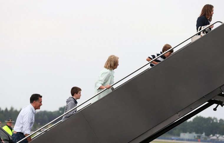 Republican presidential candidate and former Massachusetts Governor Mitt Romney (L) boards his campaign plane with his wife Ann Romney (C) in Bedford, Massachusetts. Romney is heading to the Republican National Convention for his wife's speech Tuesday evening. (Justin Sullivan/Getty Images)