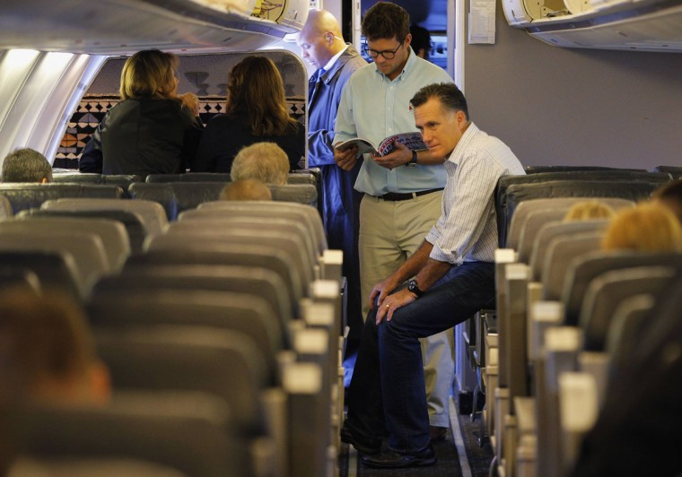Republican presidential candidate and former Massachusetts Governor Mitt Romney (R) talks to a campaign advisor on board his campaign plane in Bedford, Massachusetts. (Brian Snyder/Reuters)