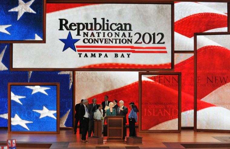 Former republican presidential candidate Newt Gingrich and his wife Callista appear on stage during a sound check at the Tampa Bay Times Forum in Tampa, Florida during the Republican National Convention. The 2012 Republican National Convention is expected to host 2,286 delegates and 2,125 alternate delegates from all 50 states, the District of Columbia and five territories. (Stan Honda/AFP/Getty Images)