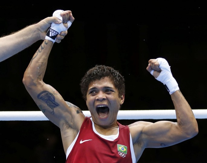 Brazil's Adriana Araujo wins against Kazakhstan's Saida Khassenova during their Women's Light (60kg) Round of 16 boxing match during the London 2012 Olympic Games August 5, 2012. (Murad Sezer/Reuters)