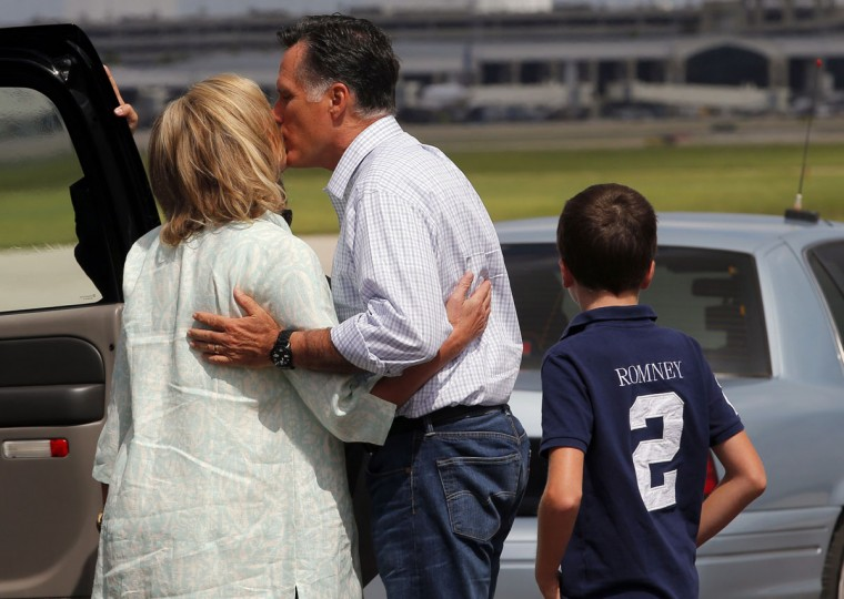 Republican presidential candidate and former Massachusetts Governor Mitt Romney gives his wife Ann (L) a kiss, as their grandson Joe (R) looks on, before they depart separately from the airport in Tampa, Florida. (Brian Snyder/Reuters)