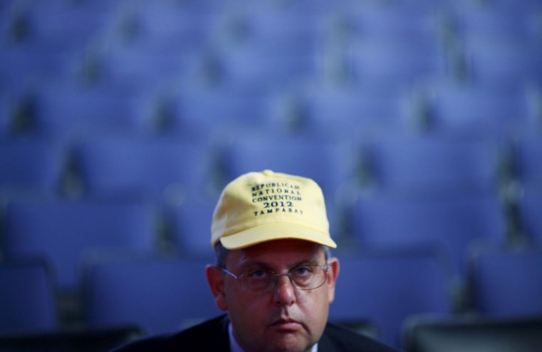 Attendee Daniel Caprio watches preparations on the convention floor before the the second day of the Republican National Convention in Tampa, Florida. (Eric Thayer/Reuters)