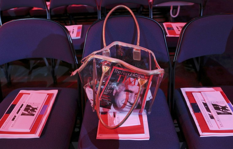 A purse containing the latest issue of Time magazine, with Republican presidential candidate Mitt Romney on the cover, is seen during the second day of the Republican National Convention in Tampa, Florida. (Eric Thayer/Reuters)
