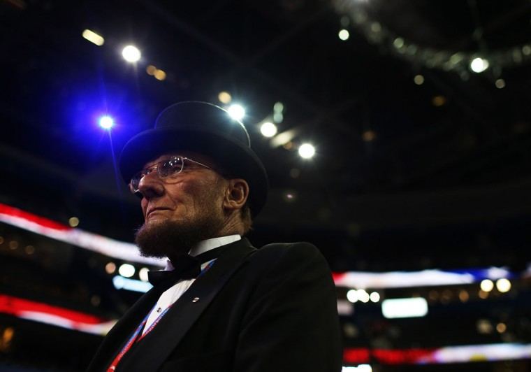 George Engelbach, dressed as former President Abraham Lincoln, stands on the floor before the start of the second day of the Republican National Convention at the Tampa Bay Times Forum in Tampa, Florida.(Spencer Platt/Getty Images)