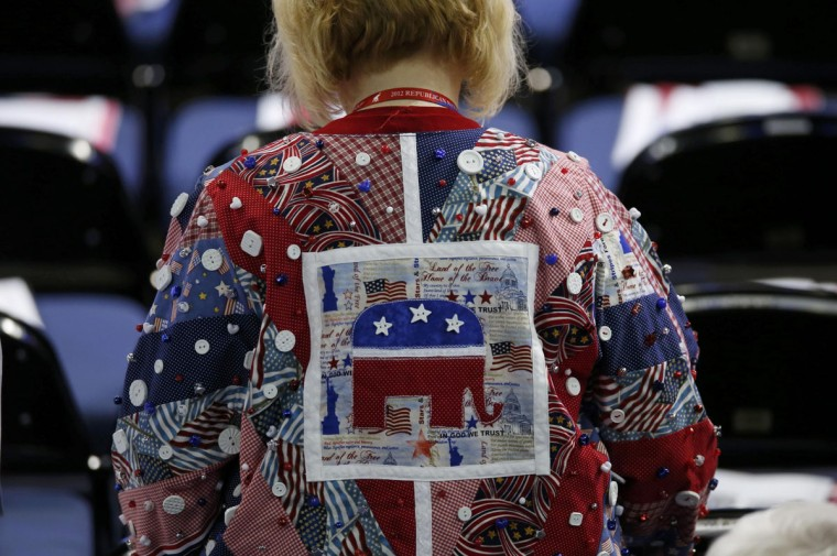 A delegate wearing a quilt shirt walks to her seat before the second session of the Republican National Convention in Tampa, Florida. (Mike Segar/Reuters)