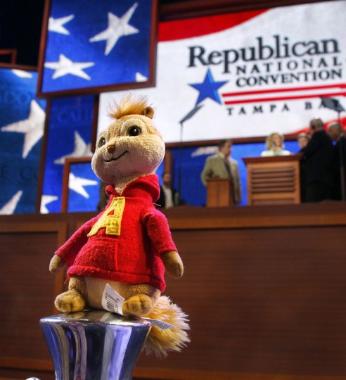 A Michigan delegate placed a stuffed Alvin from Alvin and the Chipmunks on a velvet rope stand as Ann Romney practices at the podium before the second session of the 2012 Republican National Convention at the Tampa Bay Times Forum in Tampa. (Tom Fox/Dallas Morning News)