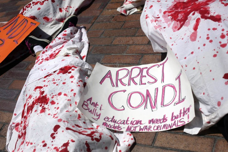 A placard is seen on the ground as members of Code Pink protest against the Iraq and Afghan wars outside of the Republican National Convention in Tampa, Florida. (Philip Andrews/Reuters)