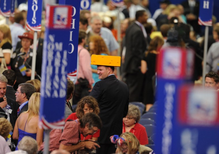 A delegate from Wisconsin sports a cheese hat at the Tampa Bay Times Forum in Tampa, Florida before the start of the day's Republican National Convention events. (Robyn Beck/AFP/Getty Images)