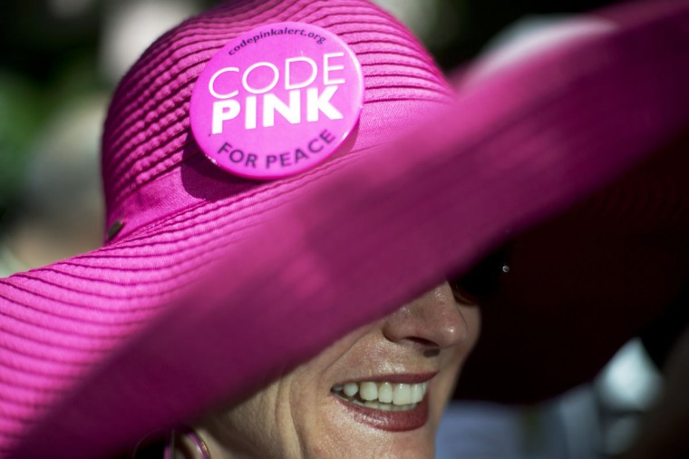 Jodie Evans, a member of Code Pink, protests against the Iraq and Afghan wars outside of the Republican National Convention in Tampa, Florida. (Philip Andrews/Reuters)