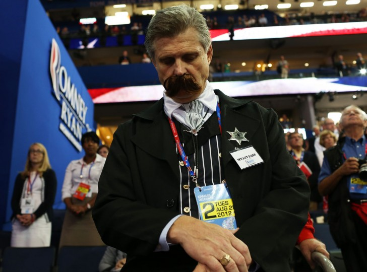 A man dressed as Wyatt Earp bows his head during the Republican National Convention at the Tampa Bay Times Forum in Tampa, Florida. Today is the first full session of the RNC after the start was delayed due to Tropical Storm Isaac. (Spencer Platt/Getty Images)