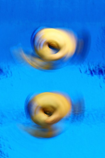 Evgeny Kuznetsov and Ilya Zakharov of Russia compete in the Men's Synchronised 3m Springboard Diving on Day 5 of the London 2012 Olympic Games at the Aquatics Centre in London, England. (Al Bello/Getty Images)