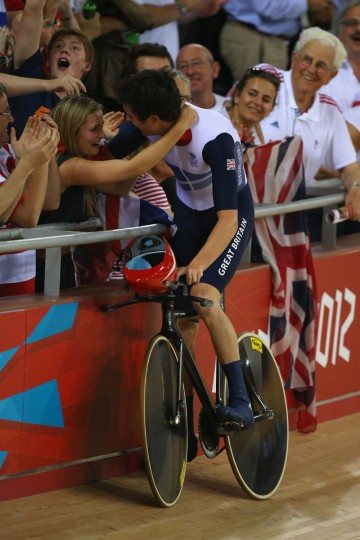 Geraint Thomas of Great Britain celebrates with his girlfriend after winning gold and setting a new world record after the Men's Team Pursuit Track Cycling final on Day 7 of the London 2012 Olympic Games at Velodrome on August 3, 2012 in London, England. (Phil Walter/Getty Images)