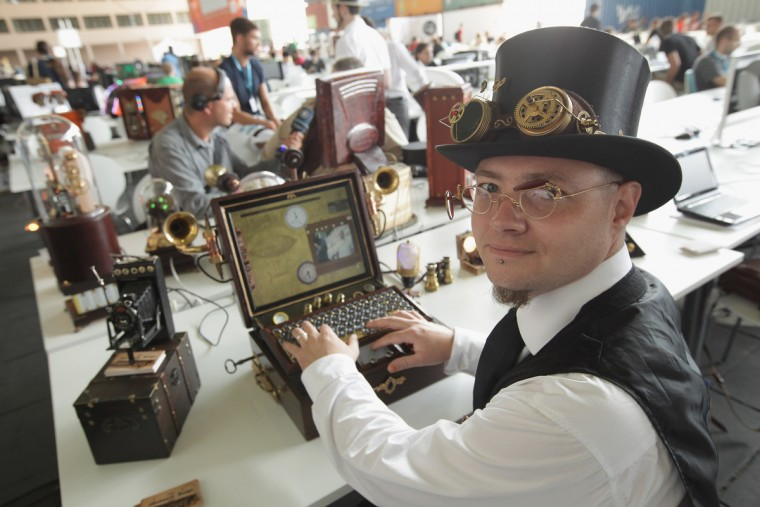 Steam punk designer Sven Mueller shows off some of his creations at the Campus Party 2012 technology festival in Berlin, Germany. The Campus Party brings together 10,000 technology enthusiasts, hackers, nerds and bloggers for five days to concentrate on finding solutions to five problems proposed through the European Digital Agenda from the European Commission. (Sean Gallup/Getty Images)