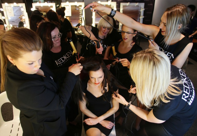 A model prepares backstage ahead of the Sportscraft show as part of the Mercedes-Benz Fashion festival Sydney 2012 at Sydney Town Hall. (Matt King/Getty Images)