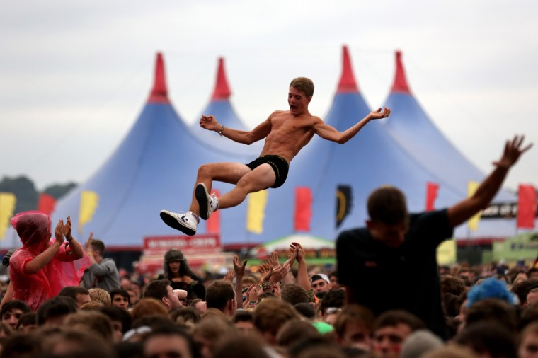 A music fan soaks up the atmosphere as You Me At Six performs live on the Main Stage during Day One of Reading Festival 2012 at Richfield Avenue in Reading, England. (Simone Joyner/Getty Images)