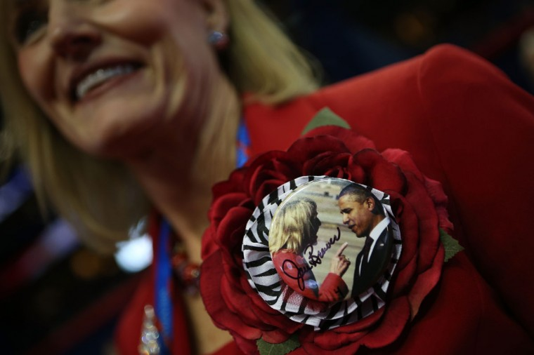 Arizona delegate Debra Jean Forrest wears a button with Arizona Gov. Jan Brewer pointing at President Barack Obama during the Republican National Convention at the Tampa Bay Times Forum in Tampa, Florida. (Chip Somodevilla/Getty Images)