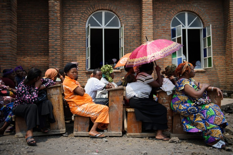 "Church-goers sit outside the Katinde Nazareen church in Goma, listening to an ecumenical service for peace in the east of the Democratic Republic of the Congo. Civil society and church leaders called on a Congolese public holiday celebrating parents, to pray for peace, saying their faith is stronger than war. North Kivu province has been wracked by conflict in recent months, as M23 rebels pitch themselves against the Congolese army. ""We will pray until this thing is over"" said one member of the congregation. (Phil Moore/GettyImages)"