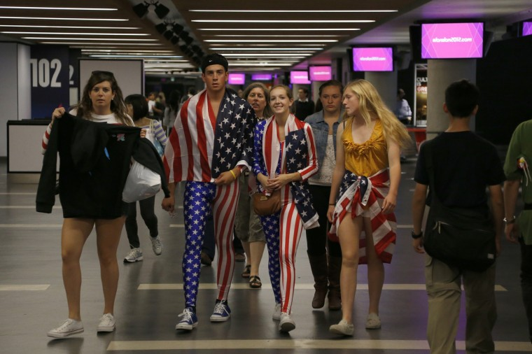 US supporters wear clothes with the US flag as they arrive at the 02 North Greenwich Arena to watch the men's individual all-around competition of the artistic gymnastics event of the London Olympic Games. (Thomas Coex/GettyImages)