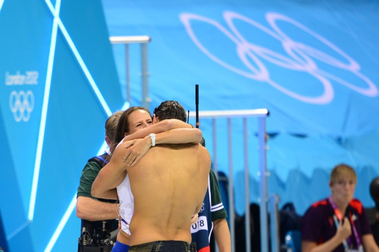 France's Florent Manaudou hugs his sister Laure after winning the men's 50m freestyle final during the swimming event at the London 2012 Olympic Games at the Olympic Park on August 3, 2012 in London. (Martin Bureau/AFP/Getty Images)