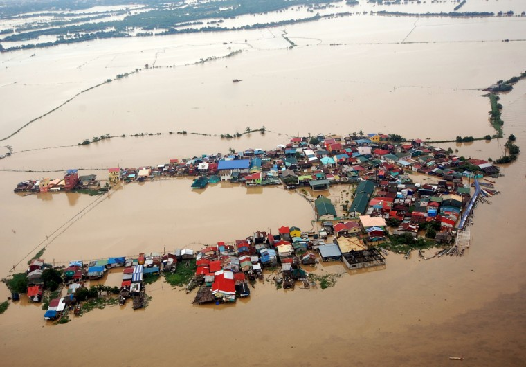 Flooding is seen around Bulacan, north of Manila. More than a million people in and around the Philippine capital battled deadly floods on August 8, as more monsoon rain fell, with neck-deep waters trapping both slum dwellers and the wealthy on rooftops. (Getty Images)