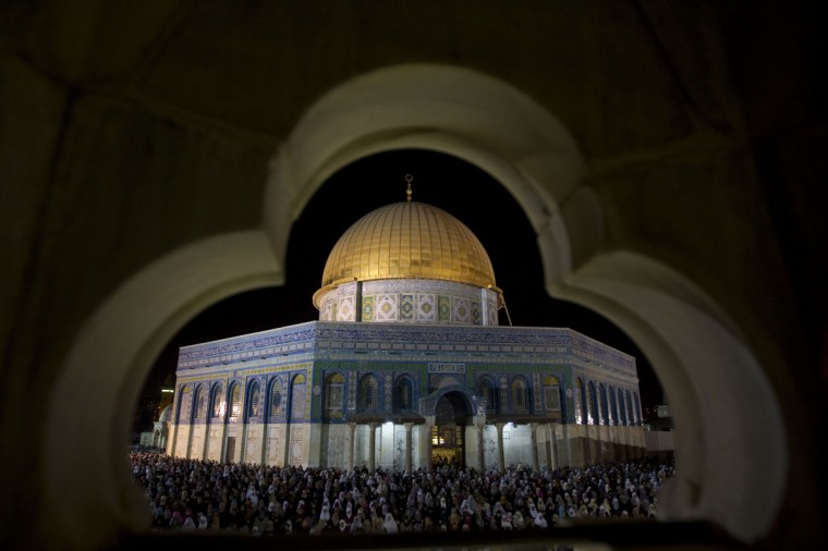 Muslim worshippers pray overnight outside at the Dome of the Rock in the Al-Aqsa mosques compound in Jerusalem's Old City on the occasion of Lailat al-Qadr which falls on the 27th day of the fasting month of Ramadan. Laylat al-Qadr, or Night of Destiny, marks the night when the first verses of the Koran were revealed to the Prophet Mohammed through the archangel Gabriel. (Ahmad Gharabli/GettyImages)