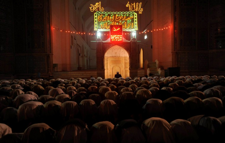 Afghan Muslim devotees pray at a mosque on Lailat al-Qader, also known as the Night of Power, the 27th night of the holy month of Ramadan in Herat late. Lailat al-Qader commemorates the night according to tradition, when the Muslim holy book the Koran, was revealed to the Prophet Mohammed through the angel Gabriel. Muslims around the world are preparing to celebrate the Eid al-Fitr holiday, which marks the end of the fasting month of Ramadan. (Aref Karimi/GettyImages)