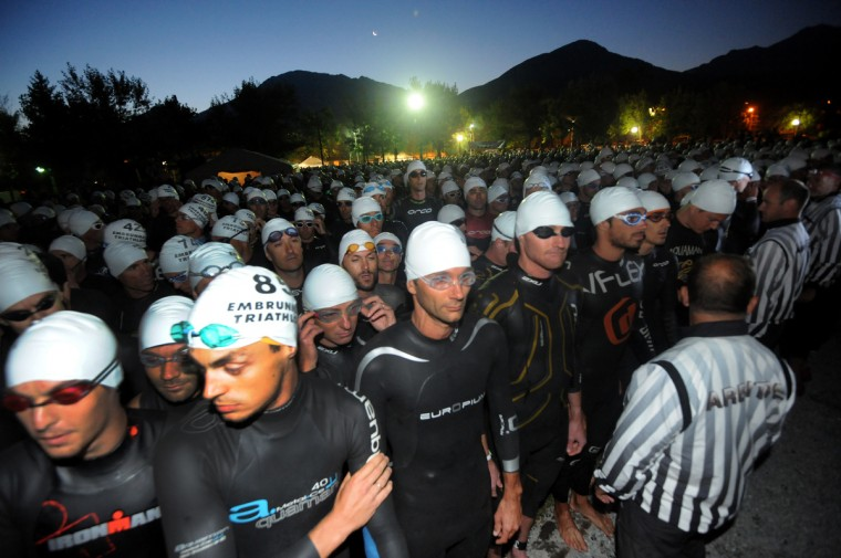 Competitors wait prior to take the start of the swimming event during the 29th edition of the Embrun Man triathlon in Embrun, southeastern France. The Embrun Man is considered as one of the hardest triathlon events with a swim of 3.8km followed by a 188km cycle ride and a 42km marathon. (Jean-Pierre Clatot/GettyImages)