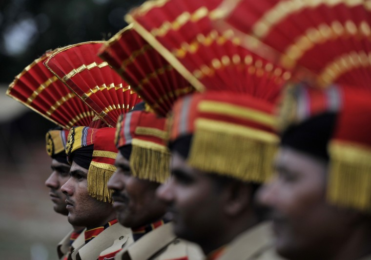 Indian Central Reserve Police Force (CRPF) stand at attention during celebrations marking India's Independence Day at The Bakshi Stadium in Srinagar. A strike, sponsored by both hardline and moderate factions of the Kashmiri's main separatist alliance, cleared the streets of the summer capital Srinagar and shut all shops and businesses. (Tauseef Mustafa/GettyImages)