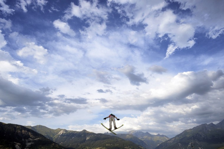 A skier competes during the 22th edition of the summer ski jumping world cup Courchevel Grand prix in Courchevel, (Jeff Pachoud/GettyImages)
