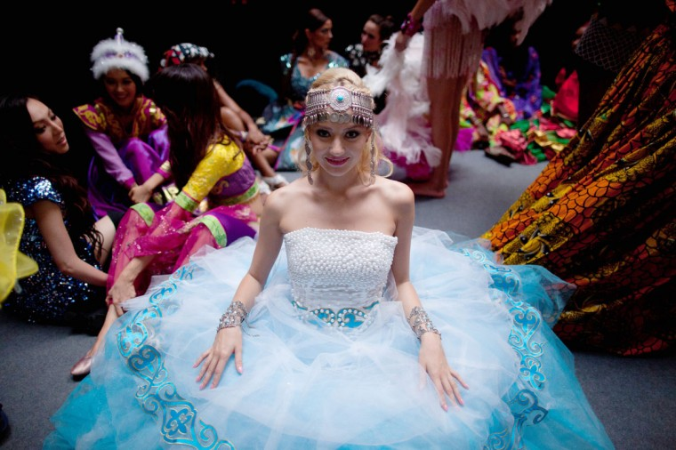 Miss World contestant, Kazakhstan's Evgeniya Klishina, waits backstage prior to a rehearsal for the final ceremony at the Ordos Stadium Arena in the inner Mongolian city of Ordos. More than 100 beauty queens from around the globe have descended on the northern Chinese mining city of Ordos on the edge of the Gobi desert ahead of the Miss World final on August 18. (Ed Jones/AFP/Getty Images)