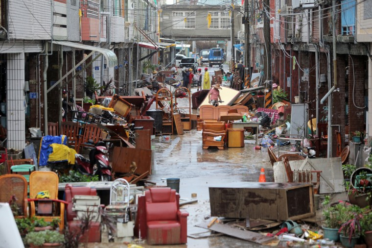 Residents affected by floods brought on by Typhoon Tembin move furniture into a street in Hengchun Township in Pingtung County, southern Taiwan. Typhoon Tembin swept across southern Taiwan on August 24, toppling trees and ripping off rooftops after thousands of people were evacuated to avoid a repeat of a deadly storm three years ago. (Getty Images)