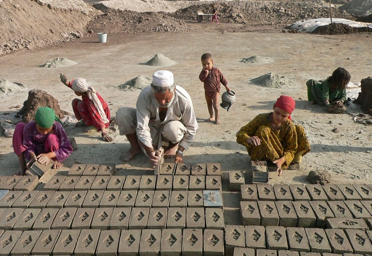 Afghan labourer Ziarat Gul, 55 (C)and family members work at a brick factory in Surkh Rood district on the outskirts of Jalalabad. Poverty and an ongoing insurgency by the ousted Taliban still pose a threat to the stability of the country.(Noorullah Shirzada/GettyImages)