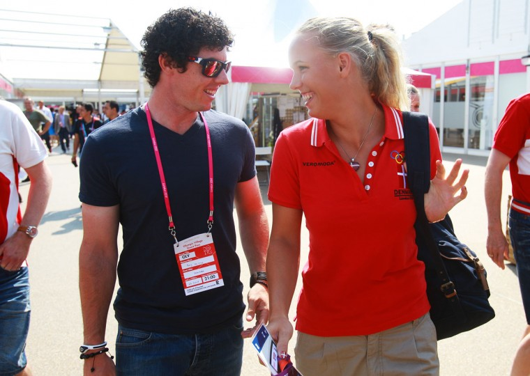 Caroline Wozniacki of Denmark and her boyfriend and golfer Rory McIlroy smile as they arrive during the Olympic Village arrivals ahead of the London 2012 Olympics at the Olympic Park on July 26, 2012 in London, England. (Alexander Hassenstein/Getty Images)