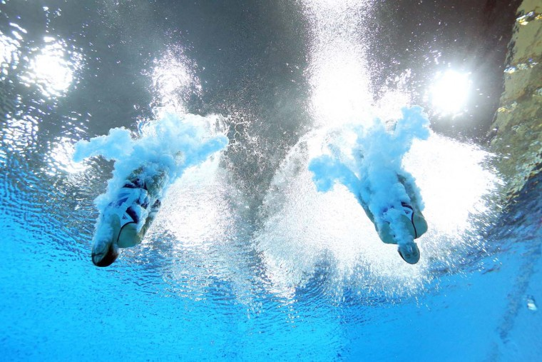 Rebecca Gallantree and Alicia Blagg of Great Britain compete in the Women's Synchronised 3m Springboard final on Day 2 of the London 2012 Olympic Games at the Aquatics Centre at Aquatics Centre on July 29, 2012 in London, England. (Al Bello/Getty Images)