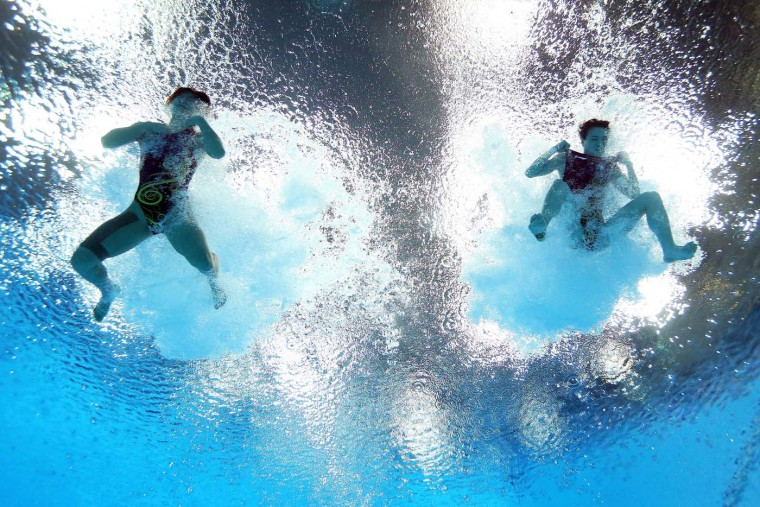 He Zi (L) and Wu Minxia of China compete in the Women's Synchronised 3m Springboard final on Day 2 of the London 2012 Olympic Games at the Aquatics Centre at Aquatics Centre on July 29, 2012 in London, England. (Al Bello/Getty Images)