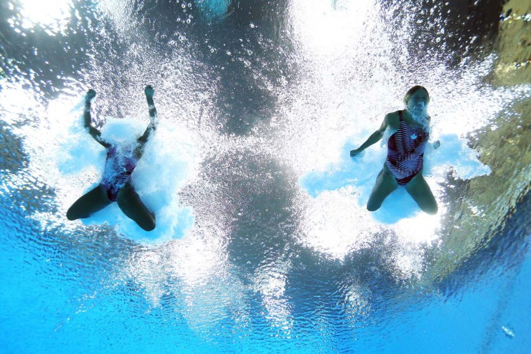 Jennifer Abel and Emilie Heymans of Canada compete in the Women's Synchronised 3m Springboard final on Day 2 of the London 2012 Olympic Games at the Aquatics Centre at Aquatics Centre on July 29, 2012 in London, England. (Al Bello/Getty Images)