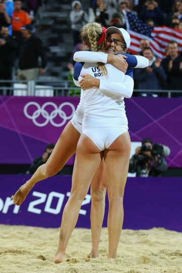 Jennifer Kessy (R) and April Ross of the United States celebrate during Women's Beach Volleyball Preliminary match between the United States and Argentina on Day 2 of the London 2012 Olympic Games at Horse Guards Parade on July 29, 2012 in London, England. (Ryan Pierse/Getty Images)