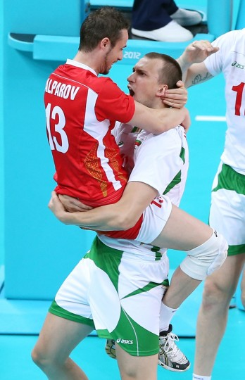 Teodor Salparov #13 and Viktor Yosifov #12 of Bulgaria celebrate the match win over Poland during Men's Volleyball on Day 4 of the London 2012 Olympic Games at Earls Court on July 31, 2012 in London, England. (Elsa/Getty Images)