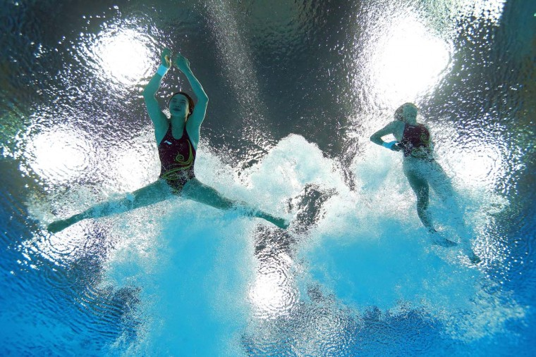 Hao Wang and Chen Roulin of China compete in the Women's Synchronised 10m Platform Diving on Day 4 of the London 2012 Olympic Games at the Aquatics Centre on July 31, 2012 in London, England. (Al Bello/Getty Images)