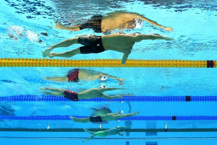 (From top) Ryan Lochte of the United States and Fenglin Zhang of China compete in heat 5 of the Men's 200m Backstroke on Day 5 of the London 2012 Olympic Games at the Aquatics Centre on August 1, 2012 in London, England. (Al Bello/Getty Images)