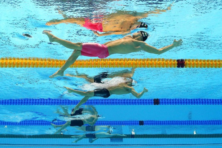 Gabor Balog of Hungary and Aschwin Wildeboer Faber of Spain compete in heat 2 the Men's 200m Backstroke on Day 5 of the London 2012 Olympic Games at the Aquatics Centre on August 1, 2012 in London, England. (Al Bello/Getty Images)