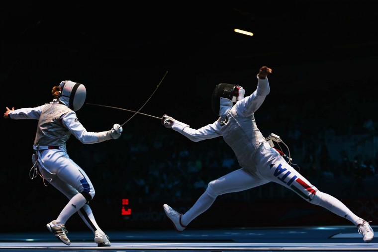 Astrid Guyart of France competes against Elisa Di Francisca of Italy in the Women's Foil Team Fencing semifinal against France on Day 6 of the London 2012 Olympic Games at ExCeL on August 2, 2012 in London, England. (Hannah Johnston/Getty Images)
