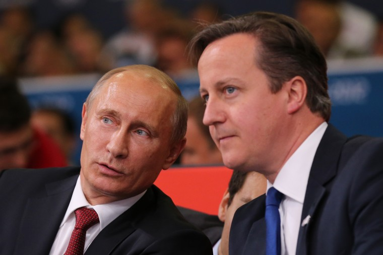 Russian President Vladimir Putin (L) watches Judo with British Prime Minister David Cameron on Day 6 of the London 2012 Olympic Games at ExCeL on August 2, 2012 in London, England. (Jeff J Mitchell/Getty Images)