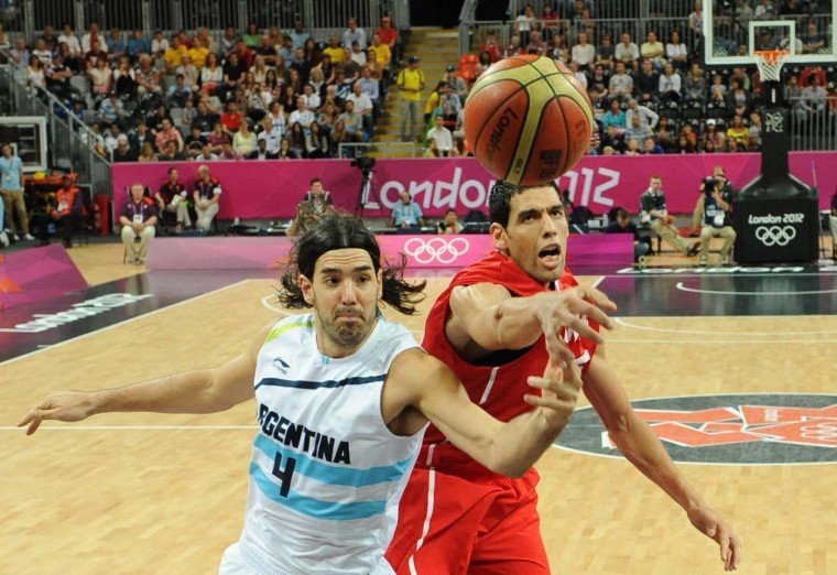 Salah Mejri (R) of Tunisia vies with Luis Scola of Argentina during the Men's Basketball Preliminary Round match between Argentina and Tunisia on Day 6 of the London 2012 Olympic Games at Basketball Arena on August 2, 2012 in London, England. (Mark Ralston - IOPP Pool /Getty Images)
